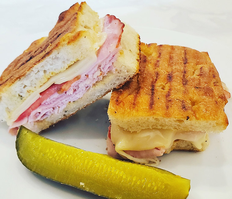 Ham panini with side pickle